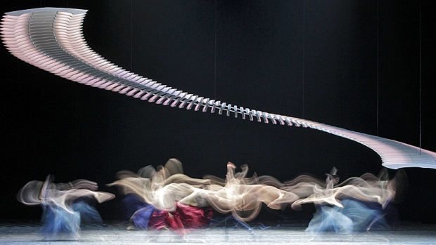 photo impressionistic image - long exposure photo shows members of the Vienna State Opera Ballet performing on stage at the Stage opera house in Vienna in February 2013. (Herwig Prammer/Reuters)